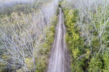 dirt muddy road in riparian forest on the shore of Missouri River near Rocheport, MO - aerial view in late October