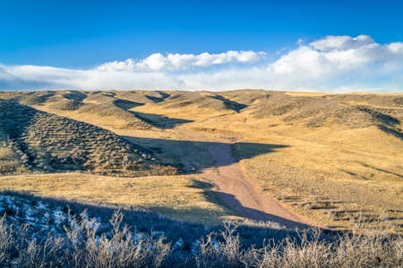 windy afternoon at Soapstone Prairie Natural Area in northern Colorado, fall or winter scenery with some snow