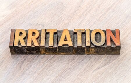 irritation word abstract in vintage letterpress wood type