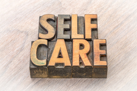 self-care word abstract in vintage letterpress wood type 写真素材