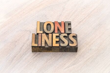 loneliness word abstract in vintage letterpress wood type Archivio Fotografico