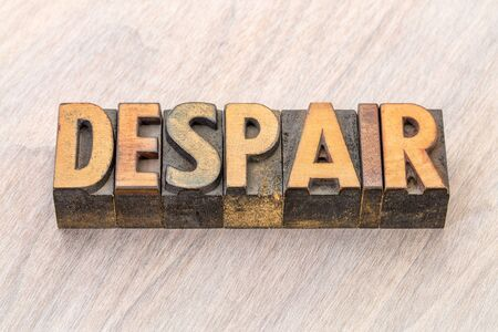 despair word abstract in vintage letterpress wood type blocks Foto de archivo
