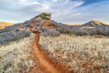 multi use trail (hiking, biking, horse riding) in Red Mountain Open Space in northern Colorado, fall scenery