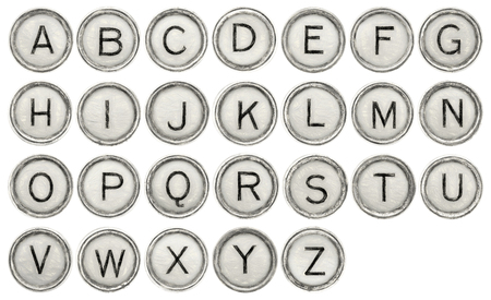 full  English alphabet set in old round typewriter keys isolated on white with digital charcoal painting filter applied