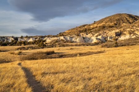 SUnset light over soapstone cliffs in  Red Mountain Open Space in northern Colorado as seen from Salt Lick Trail Stock Photo