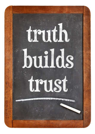 Truth builds trust - white chalk text on  a vintage slate blackboard