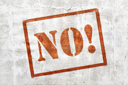NO! - red graffiti sign on white stucco wall Banco de Imagens