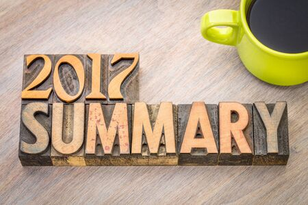 2017 summary word abstract in vintage letterpress wood type with a cup of coffee Stock Photo