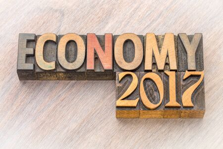 economy 2017 word abstract in vintage letterpress wood type
