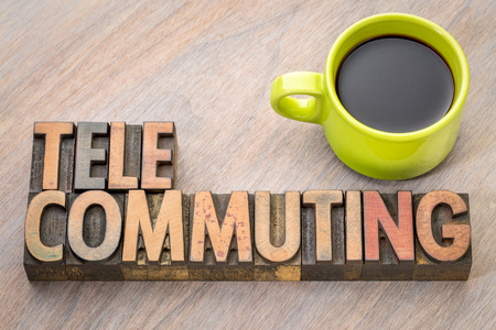 telecommuting - word in vintage letterpress wood type printing blocks with a cup of coffee Stock Photo