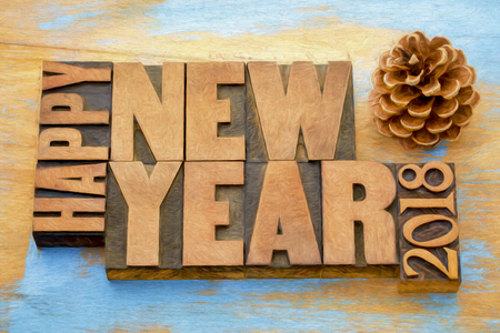 Happy New Year 2018 greeting card - word abstract t in vintage letterpress wood type blocks with a digital painting effect applied