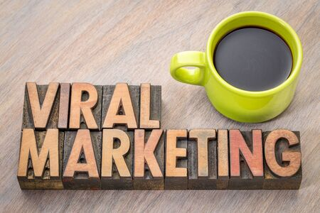 viral marketing word abstract in vintage letterpresss wood type with a cup of coffee