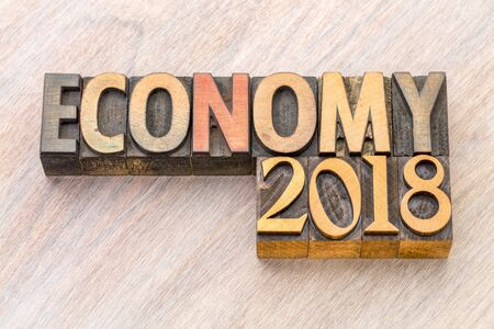 economy 2018 word abstract in vintage letterpress wood type