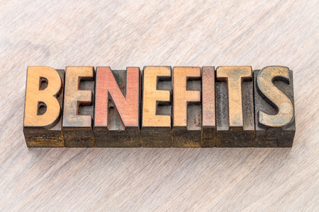 benefits word abstract in vintage letterpress wood type