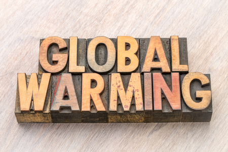 global warming word abstract in vintage wooden letterpress printing blocks, stained by color inks