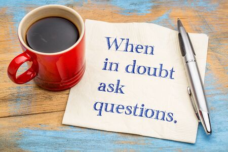 When in doubt ask questions - handwriting on a napkin with a cup of coffee Stock fotó