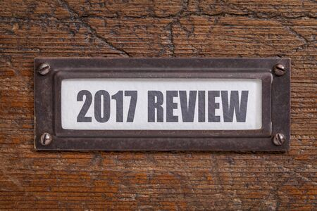 2017 review - a label on grunge wooden file cabinet. A passing year summary and review concept. Stock Photo