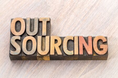 outsourcing word abstract in vintage letterpress wood type printing blocks
