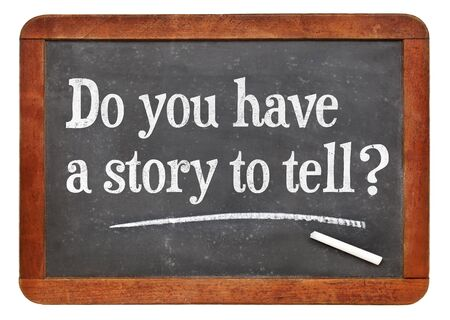 Do you have a story to tell? White chalk text on a vintage slate blackboard Banco de Imagens