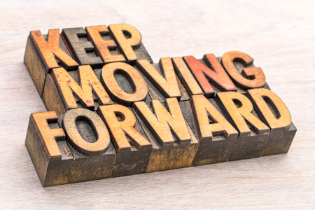keep moving forward word abstract typography in vintage lettepress wood type