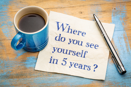 Where do you see yourself in 5 years? Handwriting on a napkin with a cup of espresso coffee Stock Photo