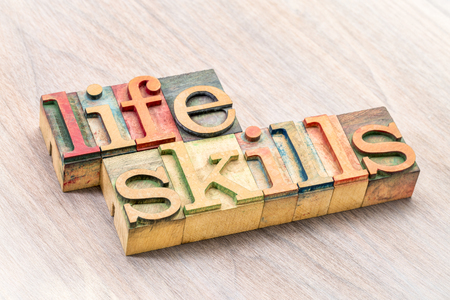 life skills - word abstract in letterpress wood type printing blocks