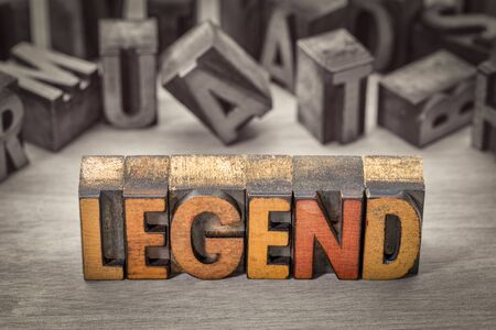 legend word abstract in vintage letterpress wood type printing blocks stained by color inks, color combined with black and white image