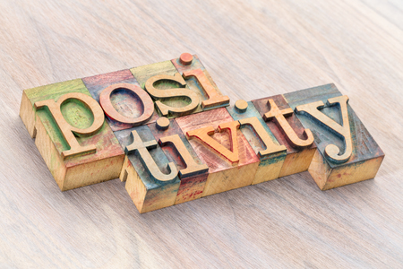 positivity word abstract in letterpress wood type printing blocks