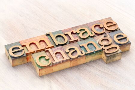 embrace change word abstract in letterprtess wood type blocks stained by color inks 스톡 콘텐츠