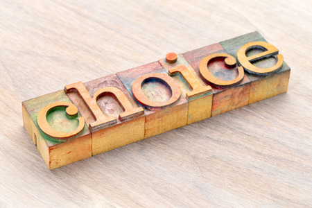 choice word abstract in letterprtess wood type blocks stained by color inks Stock Photo