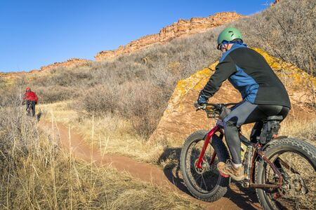 mountain bikers riding Blue Sky Trail near Fort Collins, Colorado, fall scenery