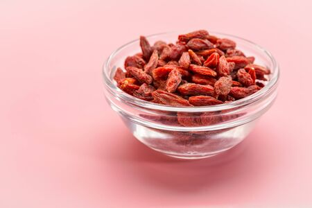 a small, glass bowl of dried red Tibetan goji berries (wolfberry) - superfruit