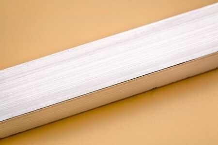 aluminum rectangular bar on beige background