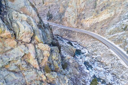 Poudre River canyon with a scenic road in winter scenery, aerial view