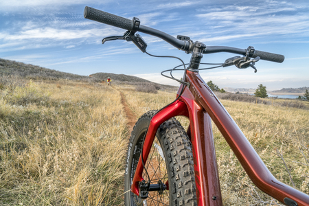 Fort Collins, CO, USA - November 3, 2017: Salsa Mukluk Carbon GX1 Fat Bike (2017) on a single track trail in Lory State Park, fall scenery. Editorial