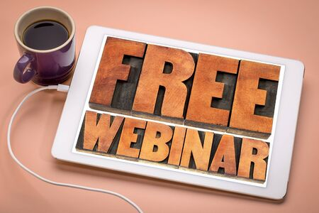 free webinar banner  - internet communication concept - a word abstract  in letterpress wood type printing blocks on a digital tablet with a cup of coffee
