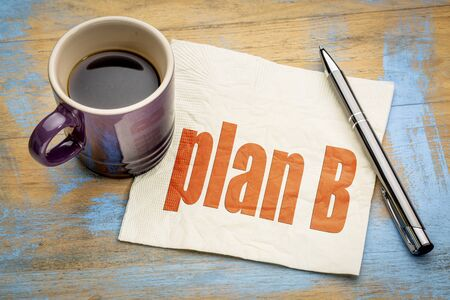plan B word abstract  on a napkin with a cup of espresso coffee Imagens