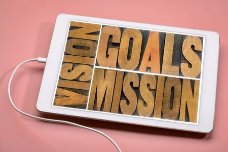 vision, goals, mission concept - word abstract in vintage letterpress wood type on a digital tablet