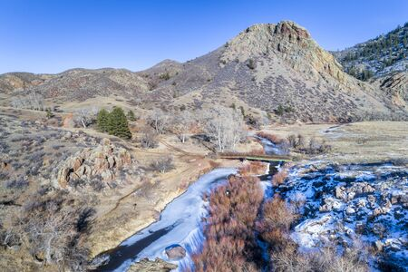 Eagle Nest Rock and partially frozen North Fork of Cache la Poudre River in northern Colorado at Livermore near Fort Collins, winter