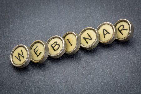 webinar word spelt in vintage typewriter keys against gray slate stone Stock Photo