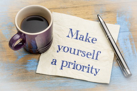 Make yourself a priority advice - handwriting on a napkin with a cup of espresso coffee Stock fotó