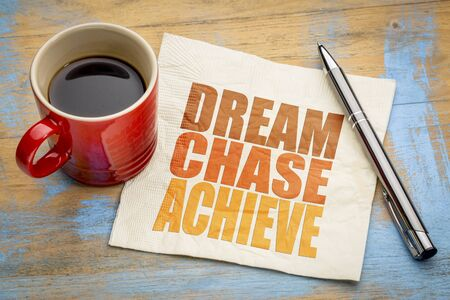 Dream, chase, achieve - inspirational word abstract on a napkin with a cup of coffee Banco de Imagens