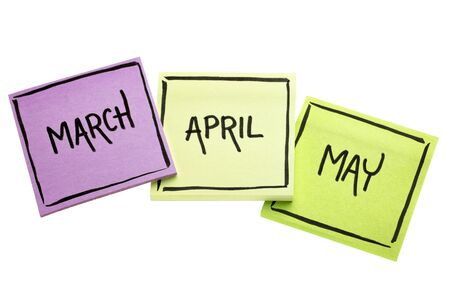March, April and May - handwriting in black ink on isolated sticky notes