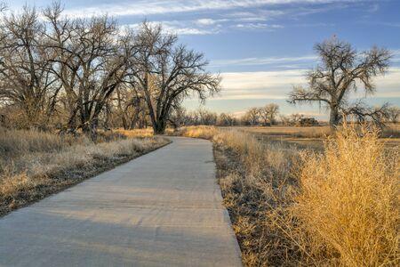 recreational trail along a river valley - Poudre River Corridor Trail near Winsor, Colorado Stock Photo