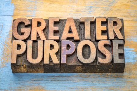 greater purpose  - word abstract in vintage letterpress printing blocks with a cup of coffee