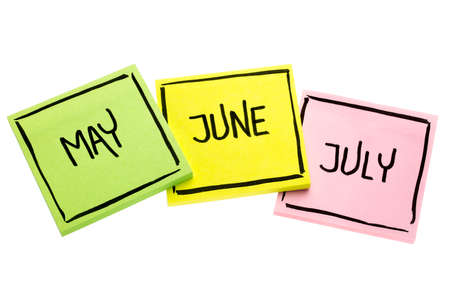 May, June  and July - handwriting in black ink on isolated sticky notes Stock Photo
