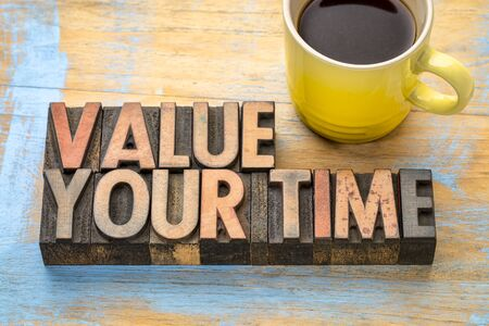value your time - word abstract in vintage letterpress printing blocks with a cup of coffee Stock Photo