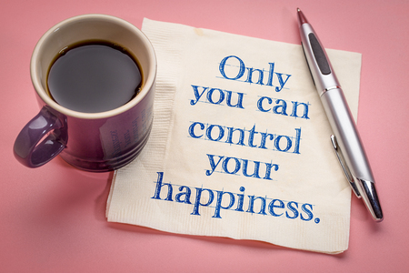 Only you can control your happiness - handwriting on a napkin with a cup of coffee Stock Photo