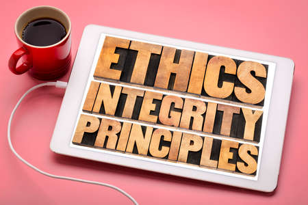 ethics, integrity and principles word abstract - ethical concept on a digital tablet with a cup of coffee Stock Photo