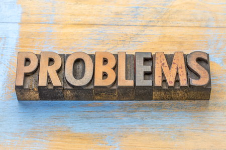 problems - word abstract in vintage letterpress  wood type